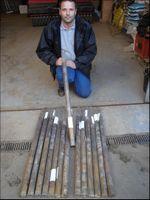 Taking soil core samples in golf greens