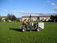 Aerating a football pitch