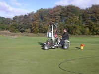 aeration of golf greens at basingstoke golf greens